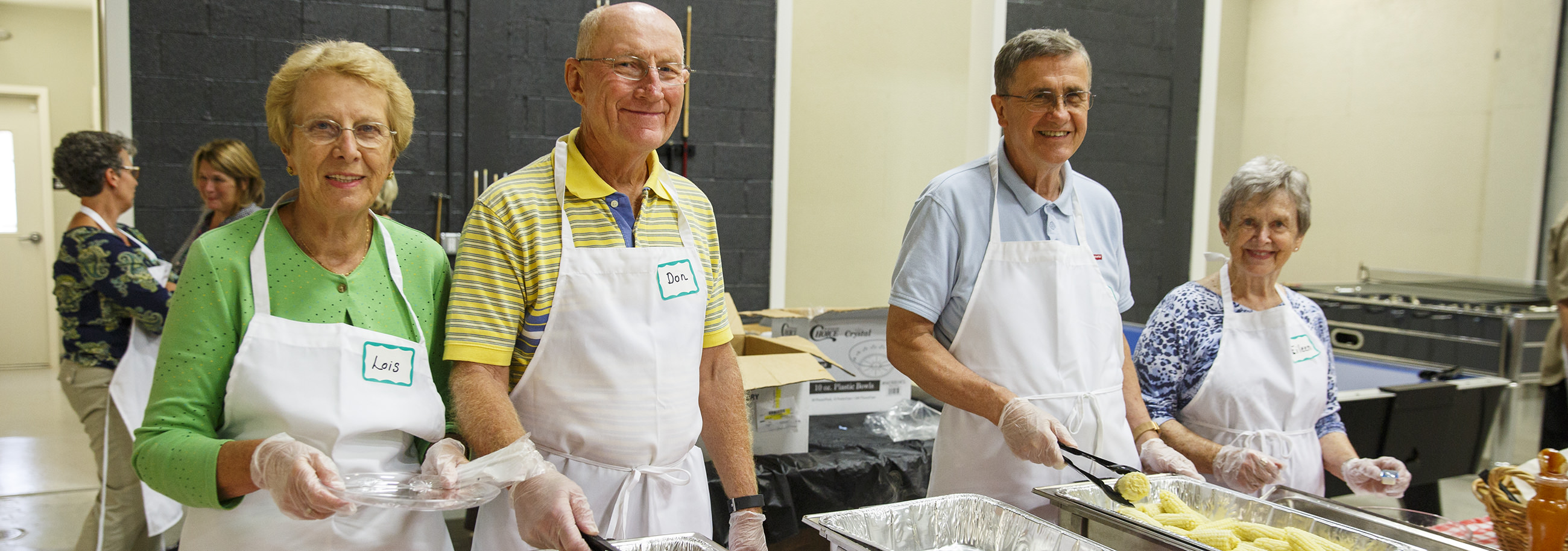 Lois and Don Aldrich and Fred and Eileen Eck coordinate a monthly community meal at CrossNet Youth Center