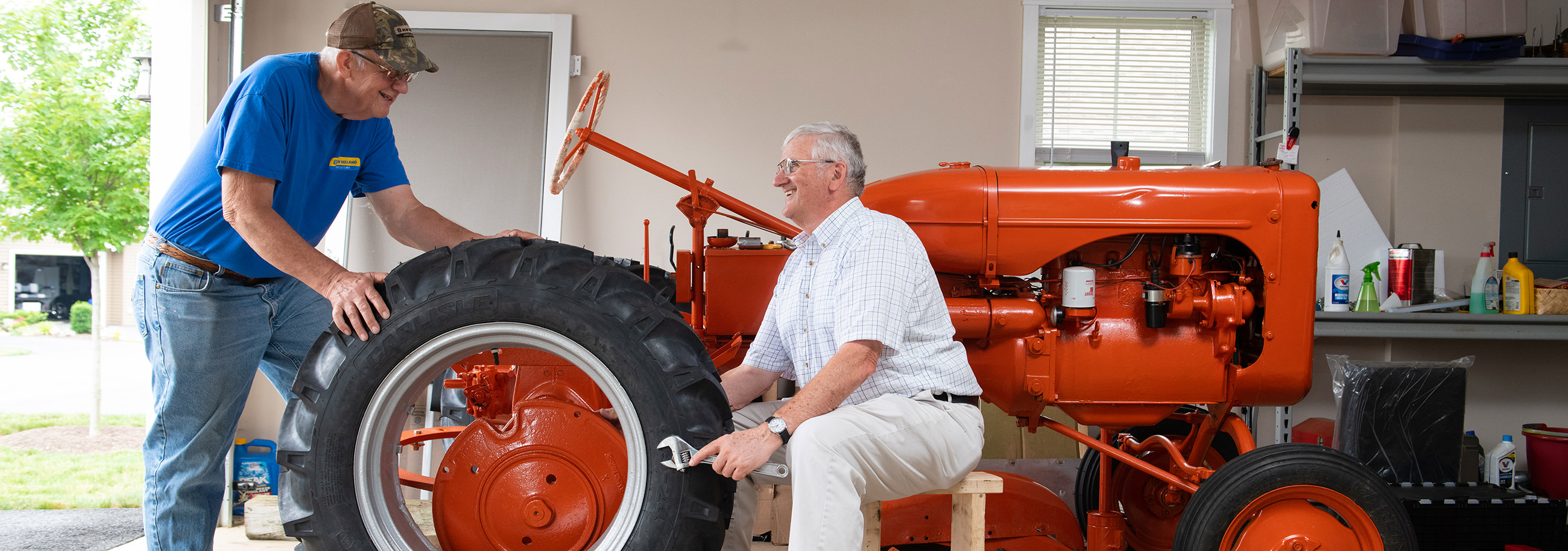 Dale Hostetter and Ed Blakeslee work on Ed's Allis Chalmers tractor in Dale's garage at Sycamore Springs.