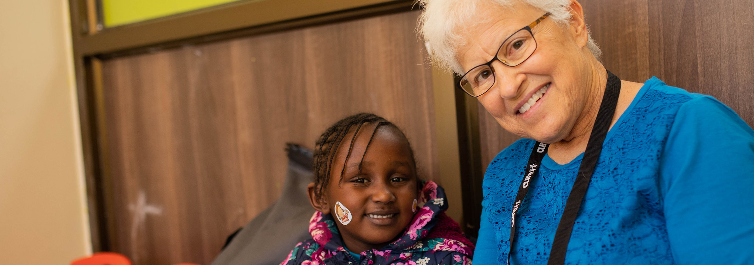 Darlene Smith connects with a young girl at the CURE Kenya hospital in Kijabe, Kenya.