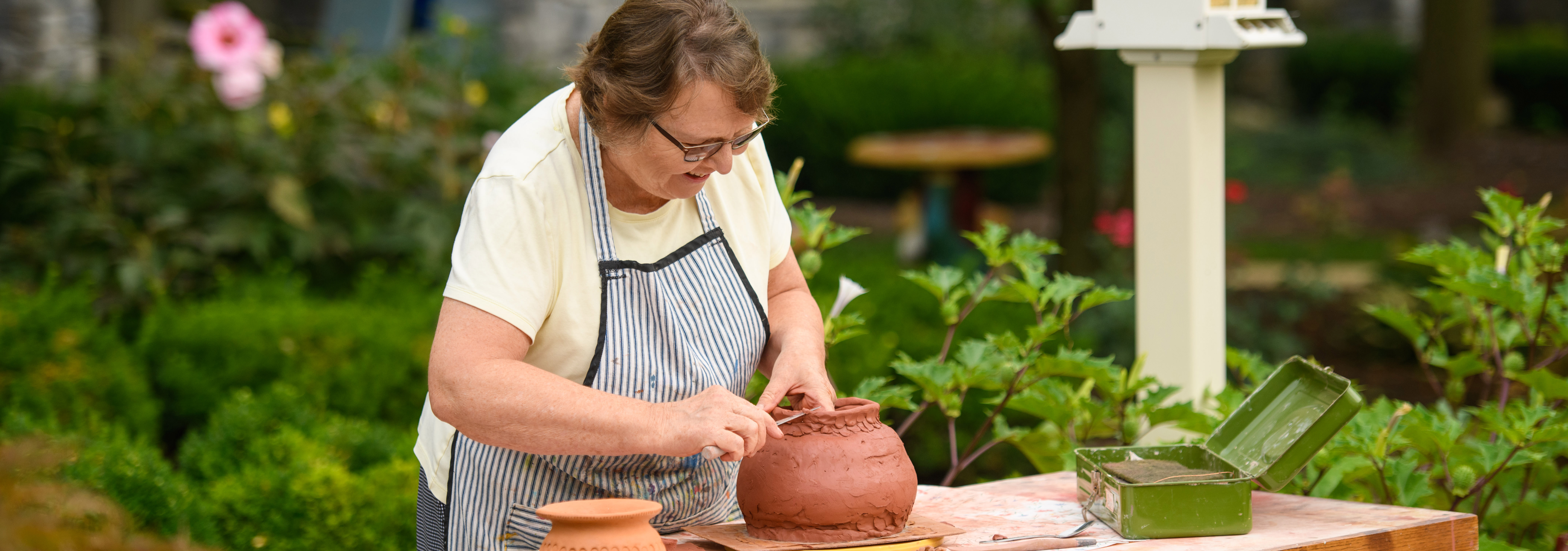 Evelyn Hershey makes traditional African cooking pots at Garden Spot Village