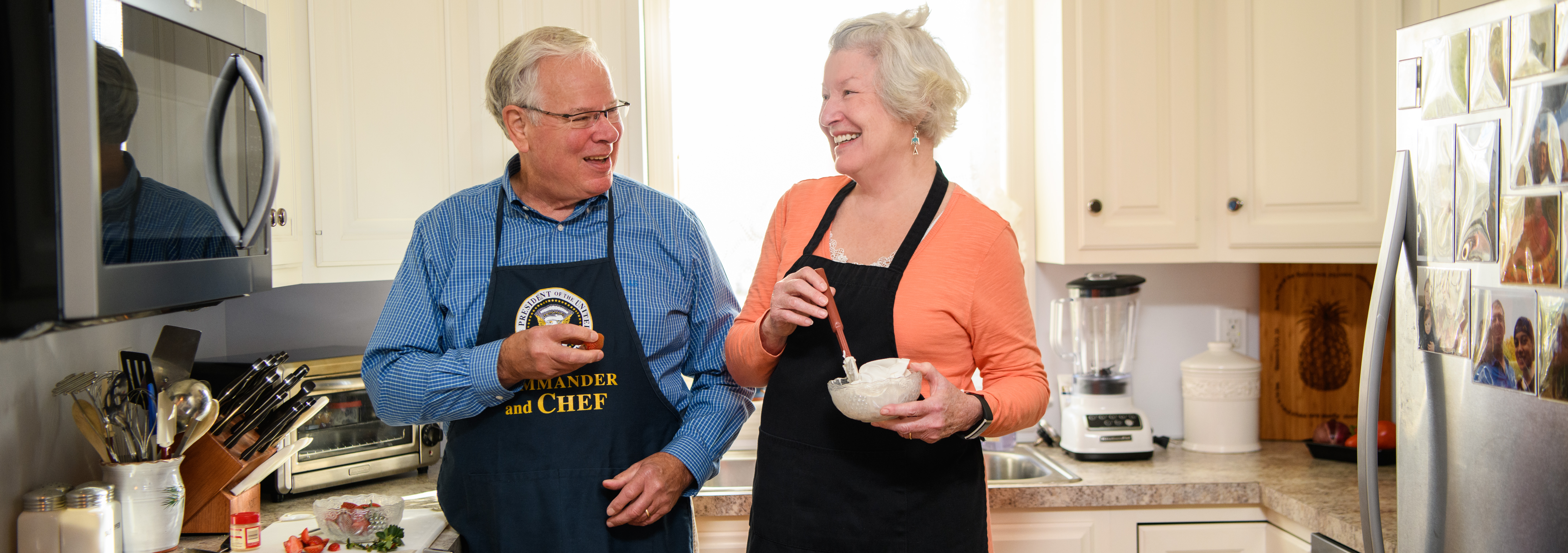 John and Sharon Sheaffer enjoy a moment in their kitchen. A retired food stylist, Sharon enjoys making delicious food look like a work of art!