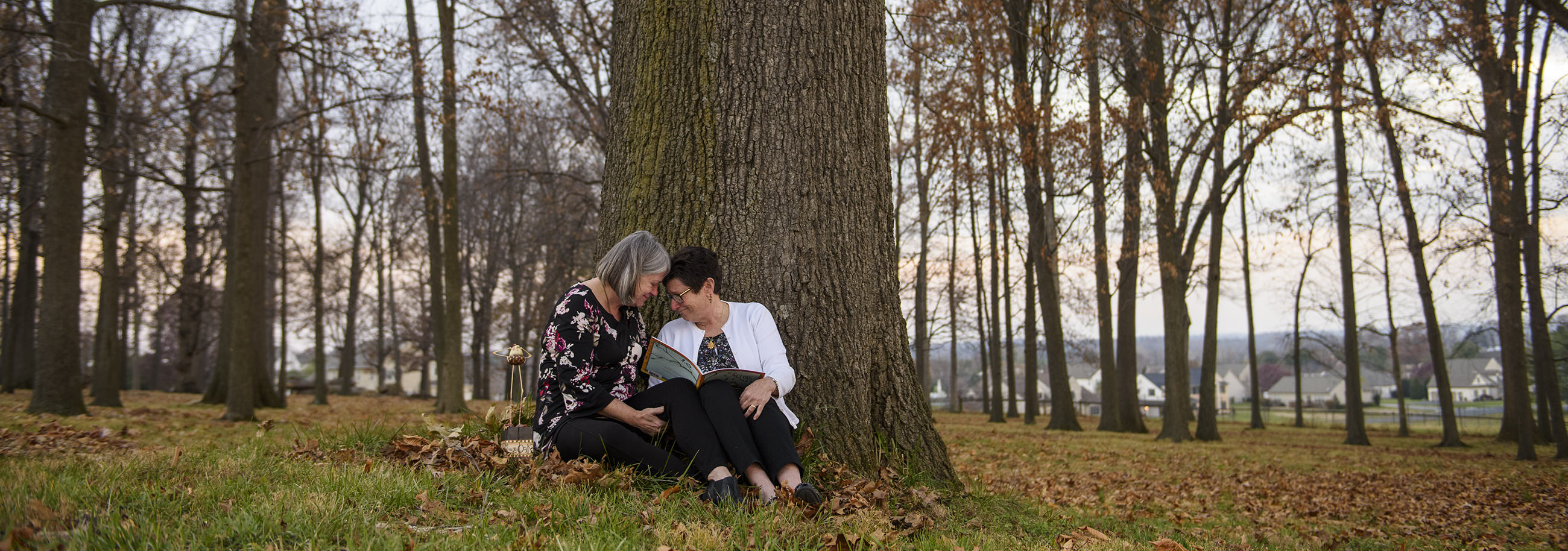 Illustrator Betsy Peterson and Garden Spot Team Member and Author Katie Mable share a quiet moment in the oak grove that inspired the Orphans and the Oak.