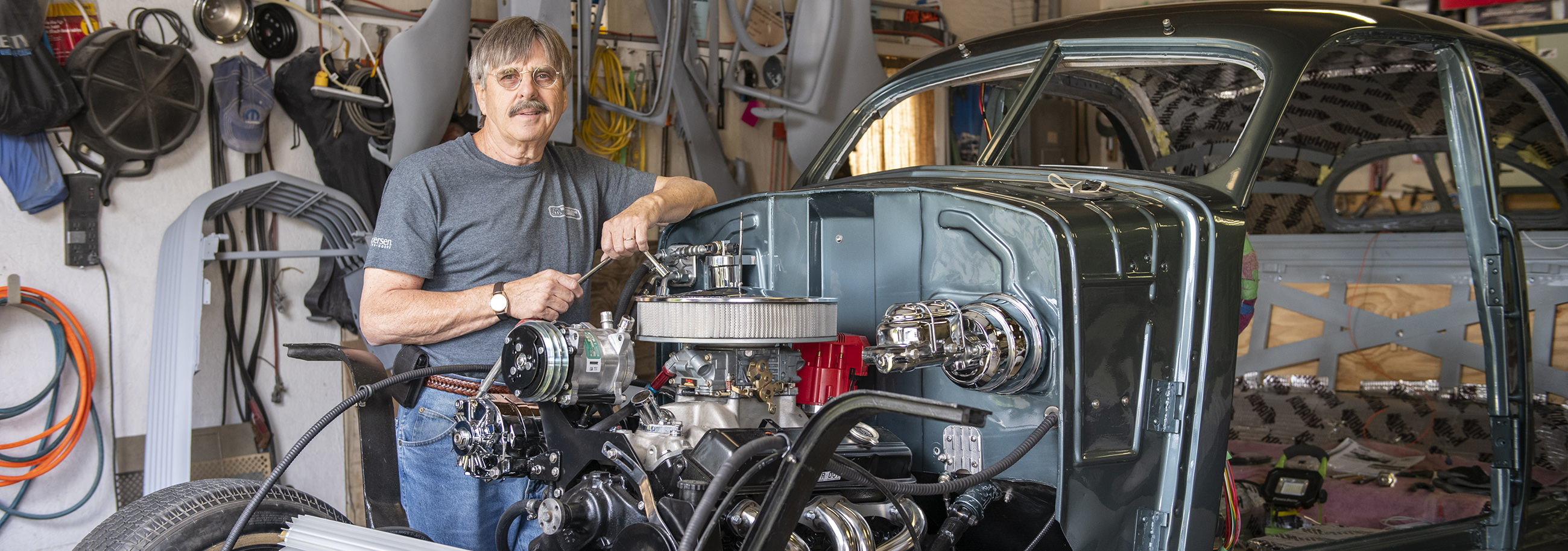 Larry Welsch restores old cars, including the 1937 Cord pictured here.
