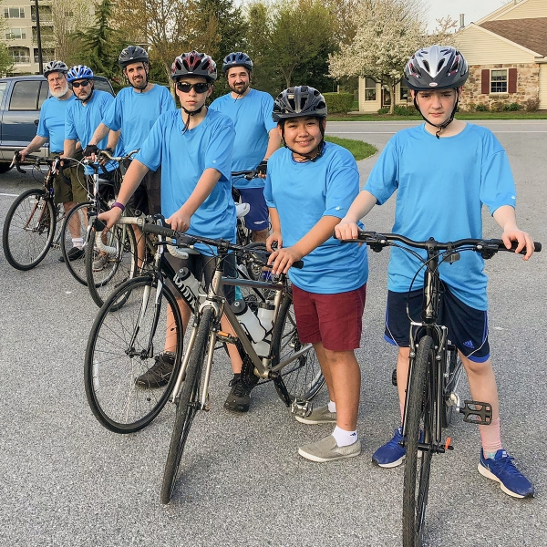 A group of boys ride bike through Lifecycles, which meets at Garden Spot Village in New Holland, Pa.