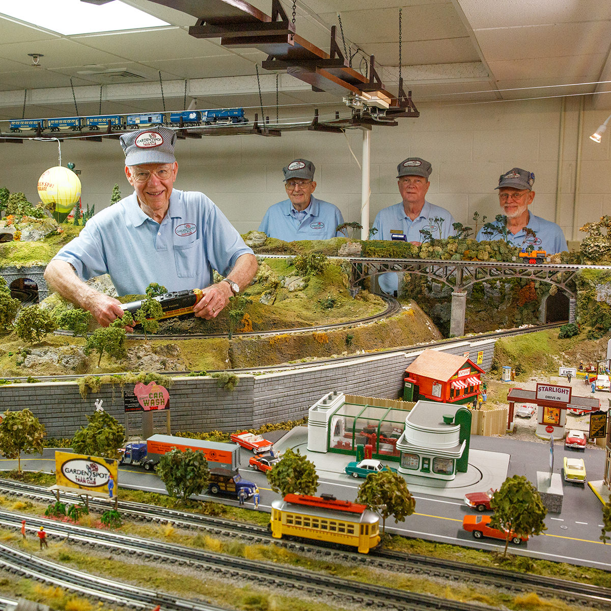 Harry Black working on train layout at Garden Spot Village Train Room