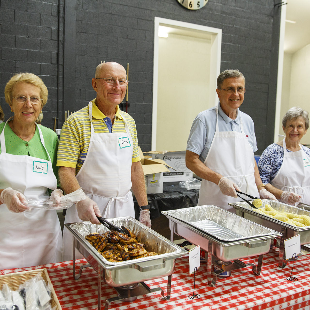 Don & Lois Adrich and Fred & Eileen Eck coordinate a free community meal at CrossNet Youth Center each month.