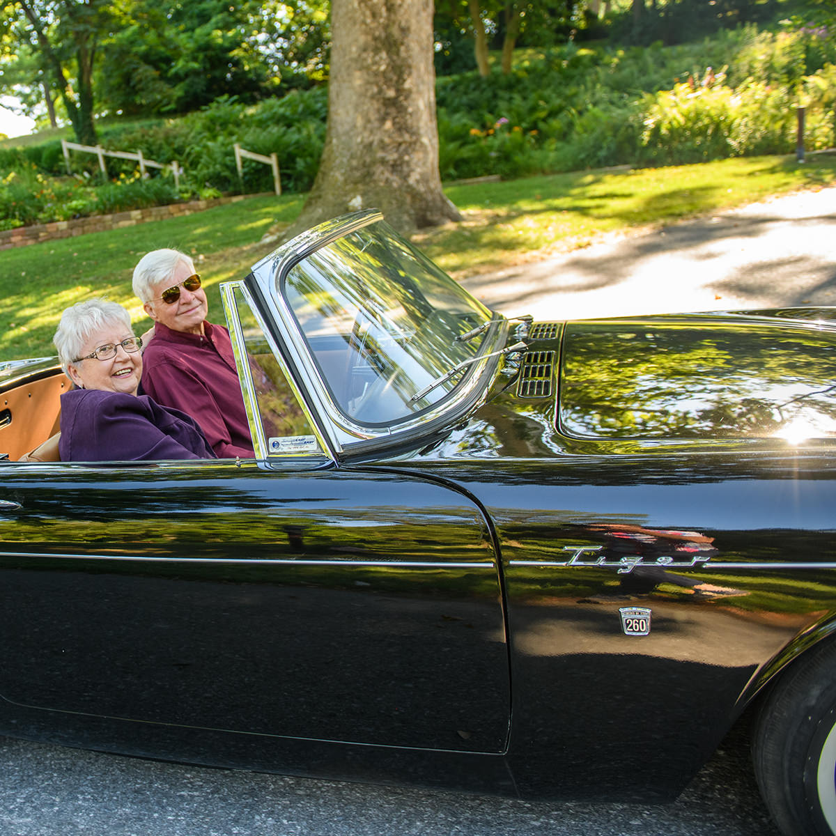 Jim and Jennie Sauer enjoy driving their Sunbeam Tiger on bright, sun-filled days.