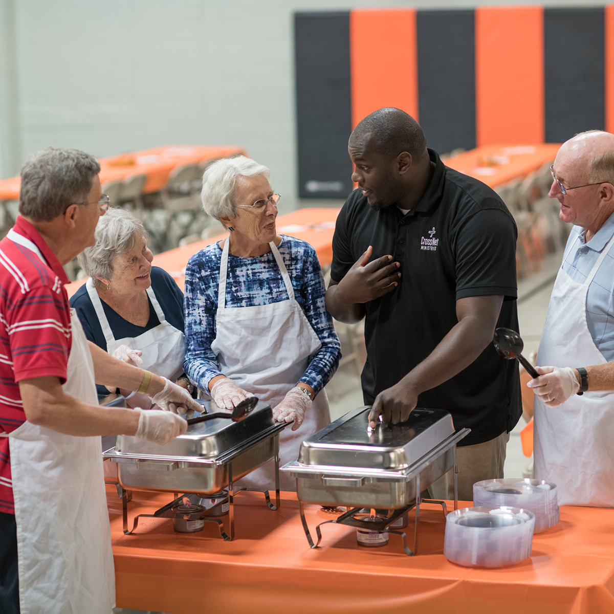 Carl Edwards, CrossNet Youth Director, works closely with Fred & Eileen Eck and Don & Lois Aldrich as Garden Spot Villages serves a community meal each month.