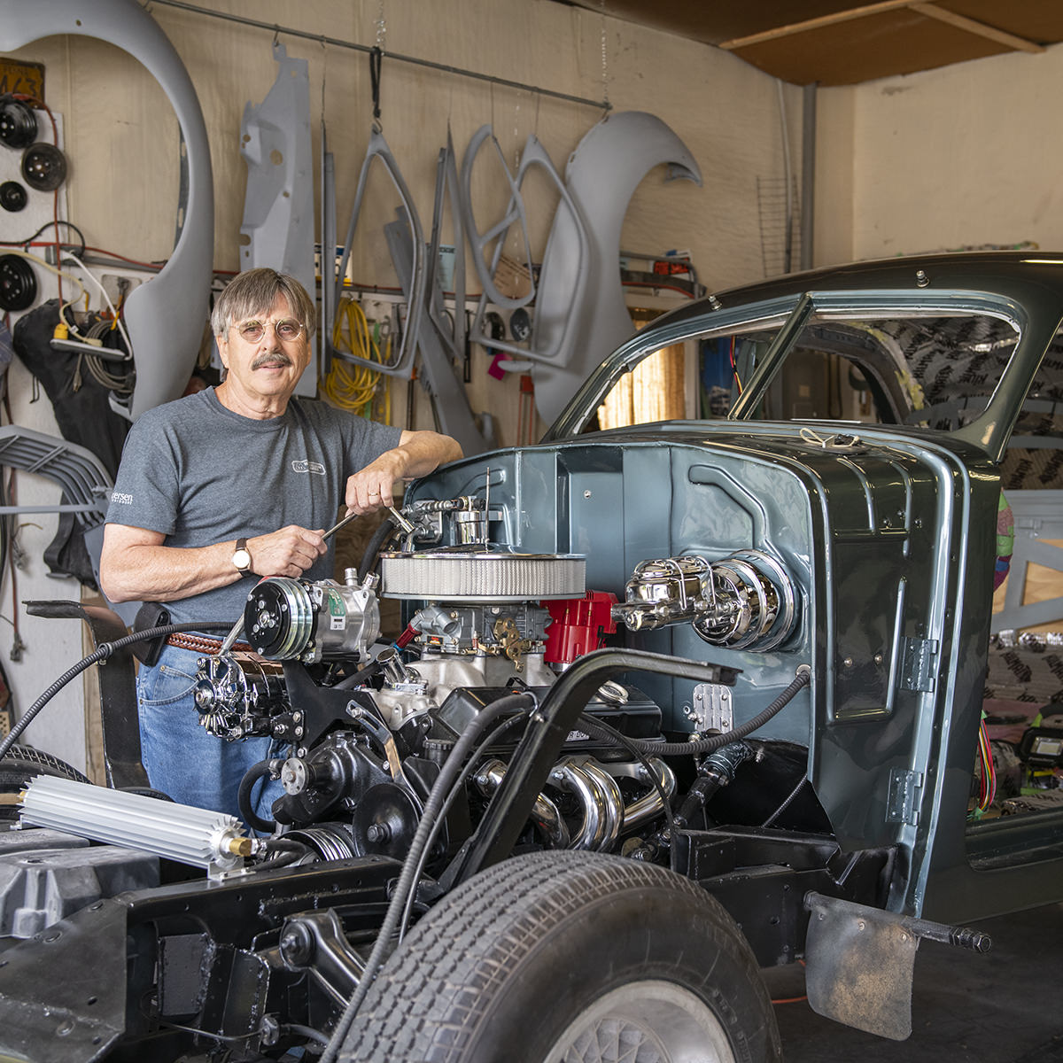 Larry Welsch buys, restores and sells old cars, including the 1937 Cord shown here.