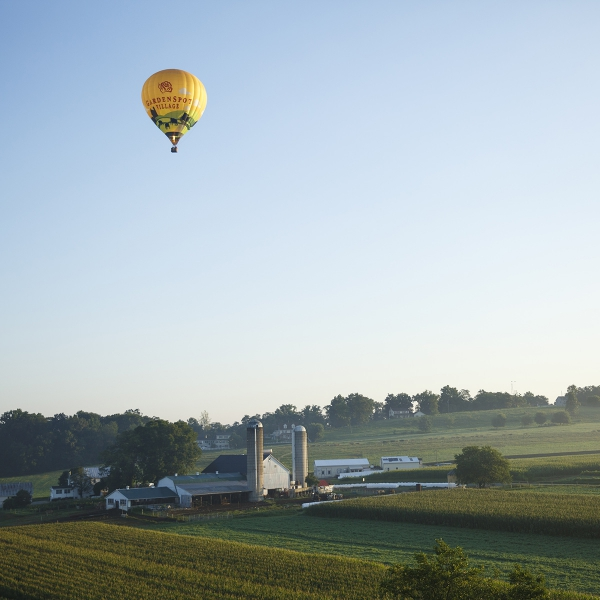 Garden Spot Village Hot Air Balloon flying over Lancaster County farmland