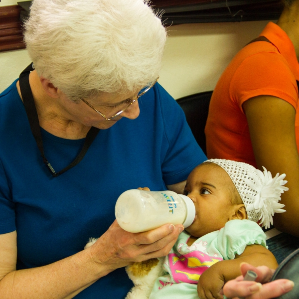 Lois Kirkpatrick holding child in CURE hospital in Santo Domingo, Dominican Republic