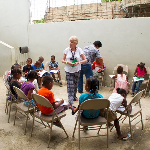 Vivian Hertzler teaching children at local school