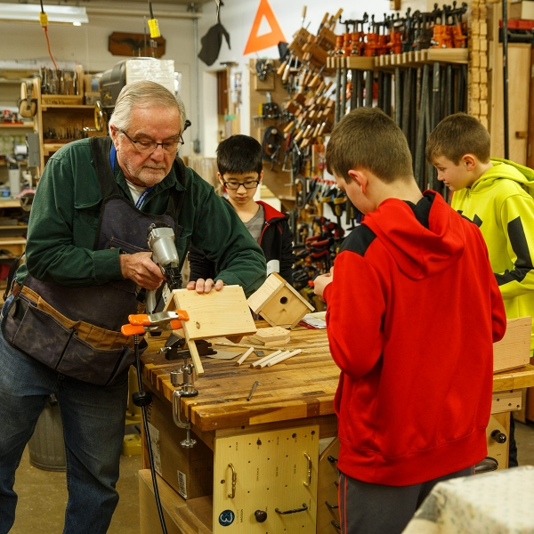 Garden Spot Village Resident John Moore works with 6th graders from New Holland Elementary School.
