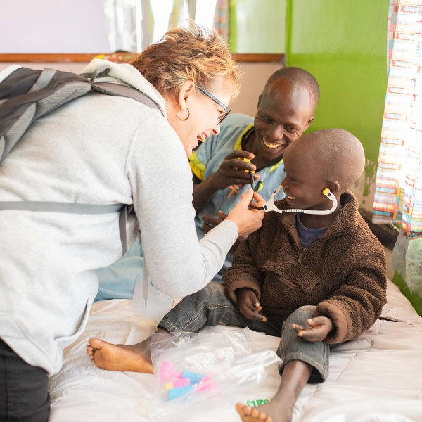 Garden Spot Village team member Janie Martin connects with a child at the CURE Kenya hospital in Kijabe, Kenya.