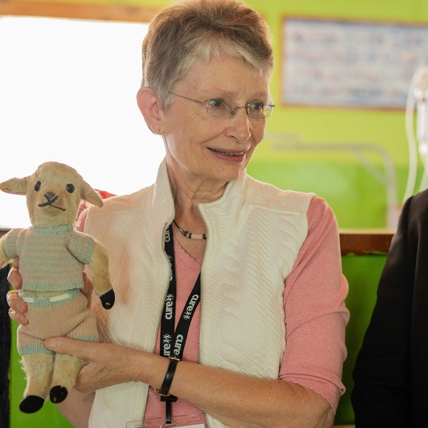 Garden Spot Village resident Marion Sacks holds her stuffed lamb as she tells a Bible story.