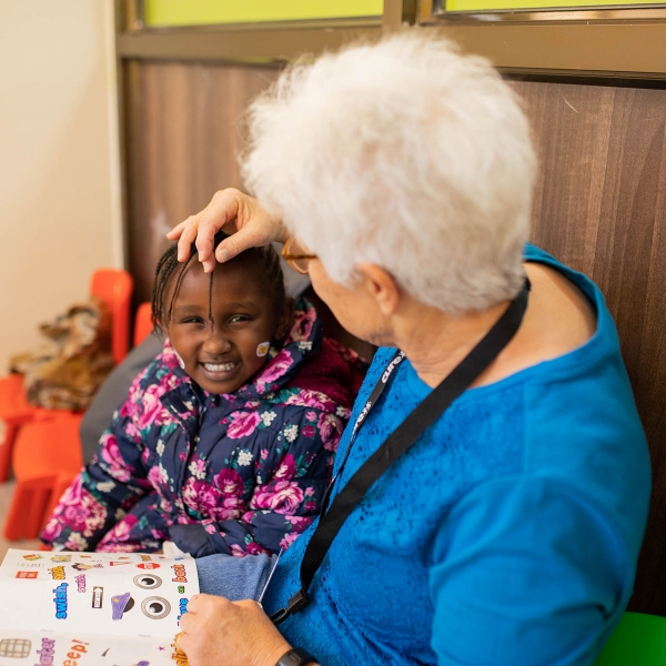 Garden Spot Village resident Darlene Smith connects with a young girl at the CURE Kenya Hospital in Kijabe, Kenya.