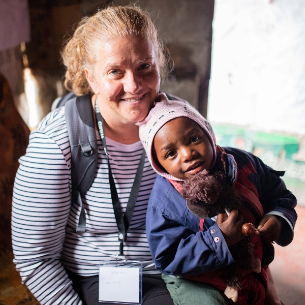 Garden Spot Village team member Amy Gallagher connects with a child during a home visit in Kijabe, Kenya.
