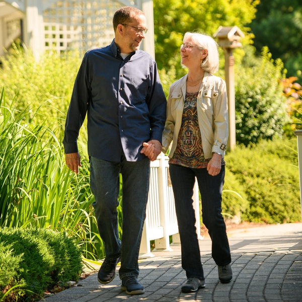 Ted and Kathy Krug walking at Garden Spot Village