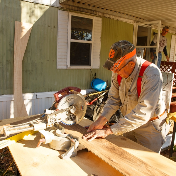 Garden Spot Village resident Ed Blakeslee works at a home in Chester County during a Garden Spot Village work day.