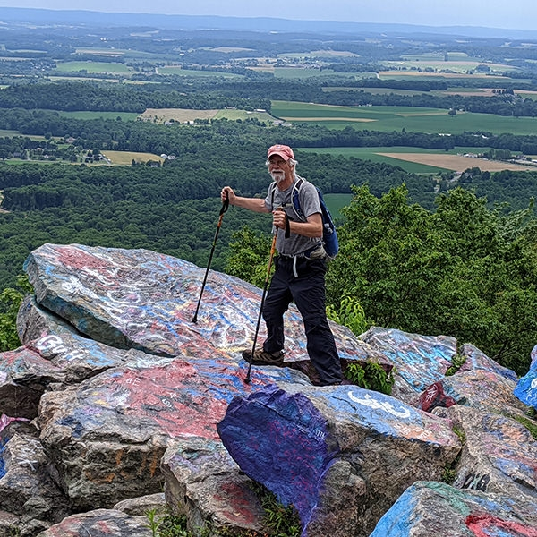 Bruce Munshower, a Garden Spot Village resident, takes a moment to enjoy the view at Bake Oven Knob on the Appalachian Trail near Germansville, Pennsylvania