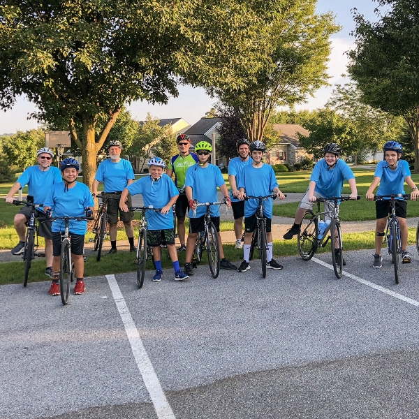 A group of boys ride bicycle with Lifecycles. The team starts and ends their ride at Garden Spot Village in New Holland.