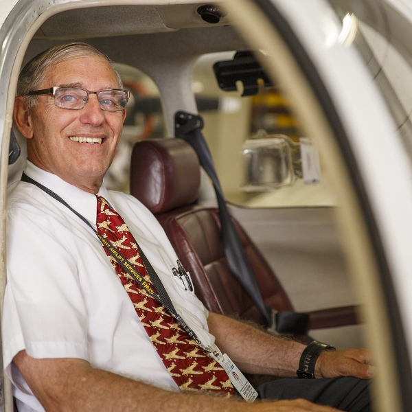 Pilot John Clough sitting in his airplane
