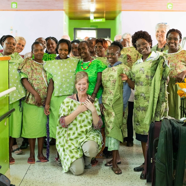 Garden Spot Village's Travel with Purpose team members pose with CURE Kenya team members and mothers of patients in October 2019.